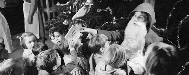 Father Christmas hands out toys at a home for evacuees, Henley-on-Thames, Oxfordshire, December 1941.