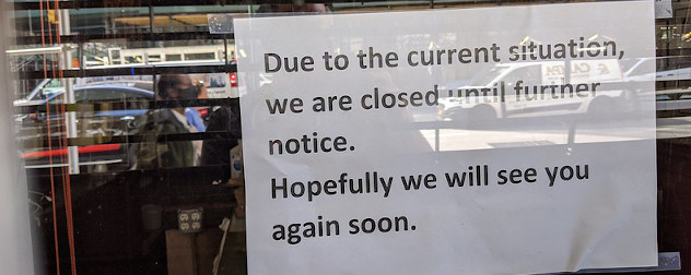 sign in the window indicating a restaurant has closed because of the COVID-19 pandemic.